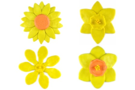 modelling: Modelling clay sunflower, daffodil and golden gardenia flower on white background