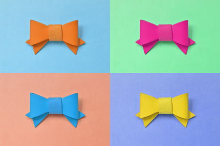 Artificial leather bow on colorful background