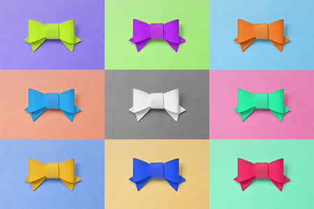leatherette: Artificial leather bow on colorful background