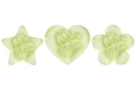 cucumis sativus: Star shaped, heart shaped and flower shaped halves of cucumber on white background