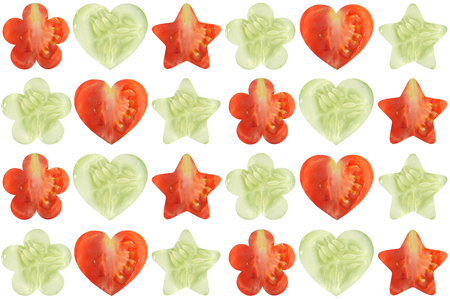 cucumis sativus: Star shaped, heart shaped and flower shaped halves of vegetables on white background Stock Photo