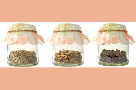 Vegetable and fruit seeds in glass bottle Stock Photo