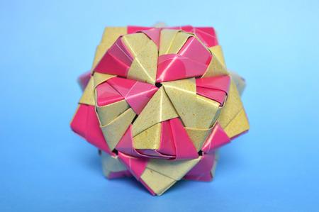 Modular origami, sonobe ball, on blue background