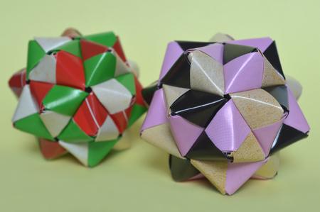 Modular origami, sonobe ball, on yellow background