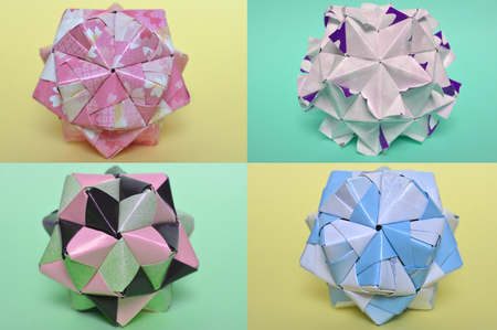 Modular origami, sonobe ball, on yellow and green background