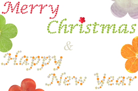 Merry Christmas and Happy New Year word from flower shaped fruit and vegetable on white background Stock Photo