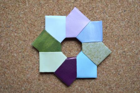 Modular Origami Ring On Cork Bulletin Board Background Stock Photo