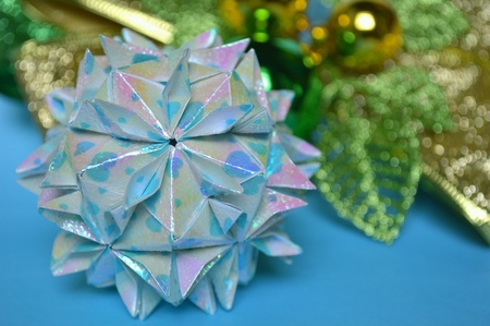 Modular origami, cherry blossom ball, on blue background