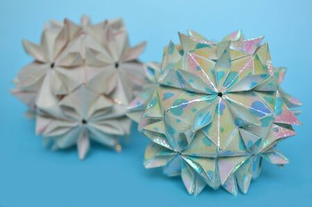 Modular origami cherry blossom ball on blue background 版權商用圖片