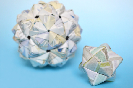 Modular origami, sonobe ball, on blue background