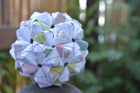 Modular origami, sonobe ball, on natural background