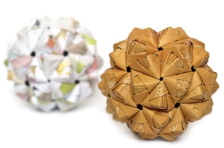 Modular origami, sonobe ball, on white background