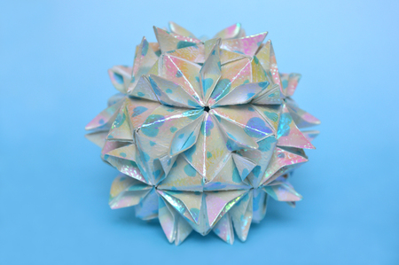 Modular origami, cherry blossom, on blue background
