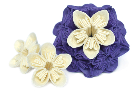 Purple and white origami kusudama flower on white background 版權商用圖片