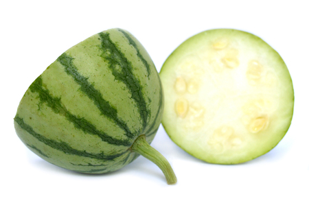 Young watermelon fruit on white background