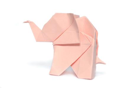 Pink origami elephant on white background