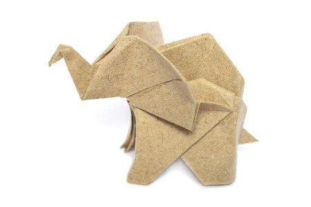 Brown origami elephant on white background