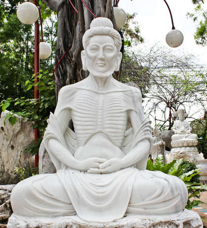 tortured body: Buddha carved out of marble
