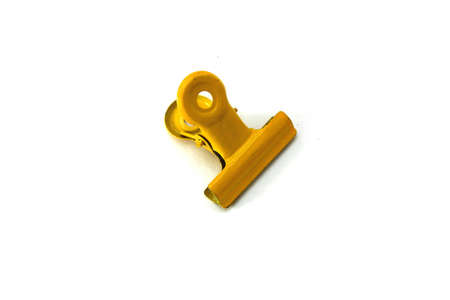 Yellow paper clip on white background Stock Photo