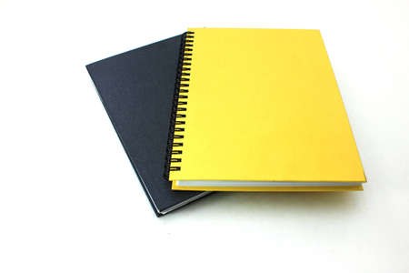 Book of black and yellow on a white background photo