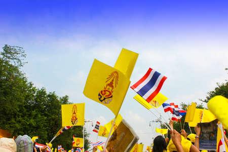 BANGKOK - DECEMBER 5: Thai people sit outside at Anantasamakom throne hall to celebrate for the 85th birthday of HM King Bhumibol Adulyadej on December 5, 2012 in Bangkok, Thailand. Stock Photo - 17069729