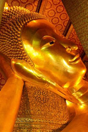 Giant reclining Buddha statue, Wat Pho, Bangkok, Thailand Stock Photo - 17190010