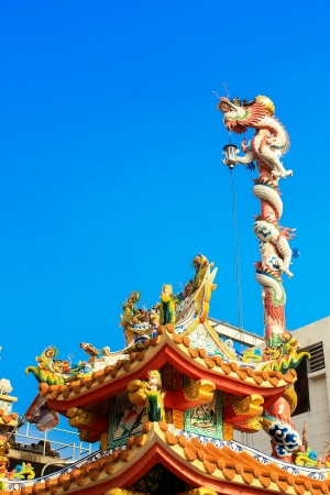 Dragon on pole in Chinese temple