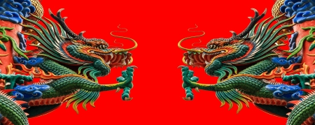 Dragon  statue on a red background  photo