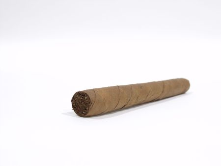 An isolated long wrapped cigar on a white surface
