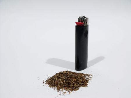 Black lighter and a pile of tobacco Stok Fotoğraf