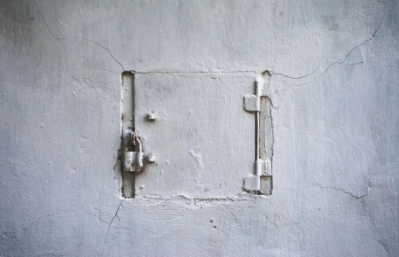 Locked door in a wall background Stock Photo