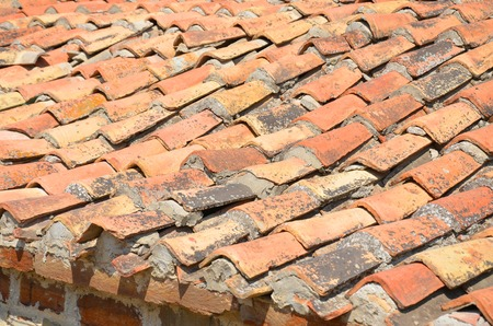 Close-up of terracota like roof tiles.
