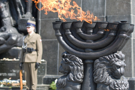 rising dead: Warsaw Ghetto Monument - Menorah with burning flame Editorial