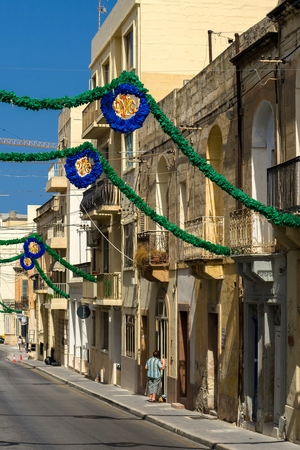 feast day: Malta, St Pauls Bay - Narrow street before feast day of its saint patron