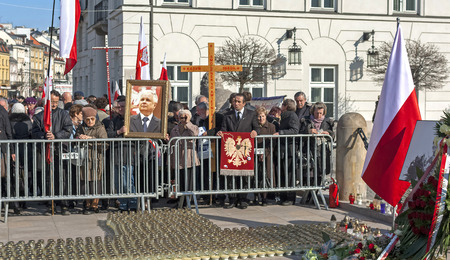 demonstrators: Warsaw, Poland - April 10, 2015: 5th anniversary of Smolensk airplane crash that killed President Lech Kaczynski, his wife Maria and 94 other officials. Demonstrators in front of the Presidential Palace. Editorial