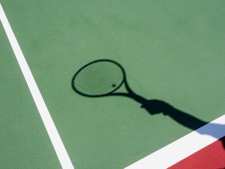 tennis courts: Shadow recquet on tennis court