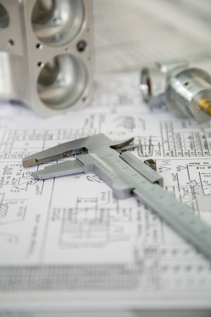 vernier caliper: measuring tool and workpiece rests with the drawing Stock Photo