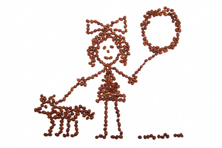 Child s drawing girl with a balloon walking with a dog from coffee beans photo