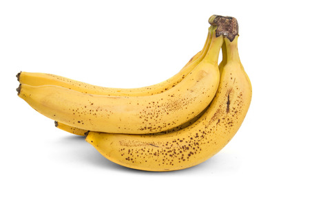 bunch of ripe bananas with dark spots on a white background Banco de Imagens