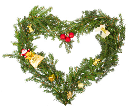 Christmas frame in the shape of a heart with yellow decorations photo