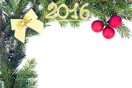 Christmas frame from fir branch with white bow and red ball