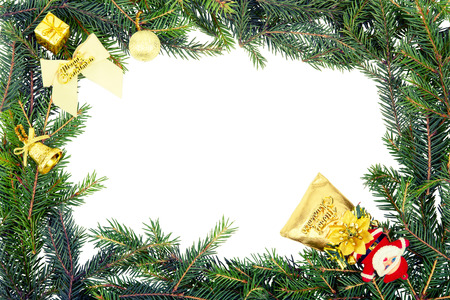 Christmas frame from fir branch with white bow,santa and yellow decorations.retro toning