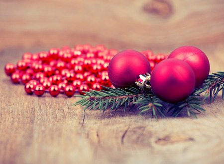 Red Christmas decoration on rustic wooden background.retro toning