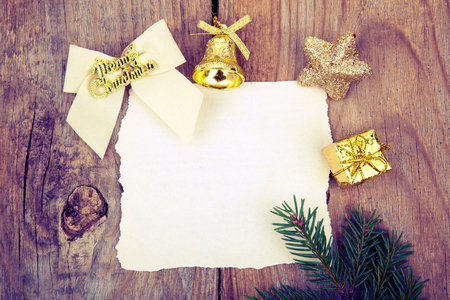Christmas gold toy and paper on old wooden background.retro toning.copy space