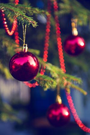 Christmas decorations on fir branch at sunset.vintage toning Banco de Imagens