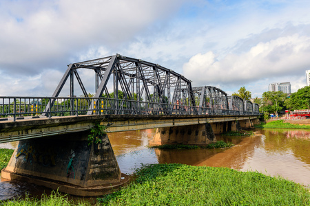 Iron bridge across river in Thailand.