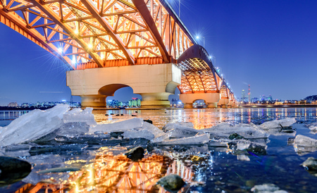 Bridge over the river in Korea on the day the river becomes ice.
