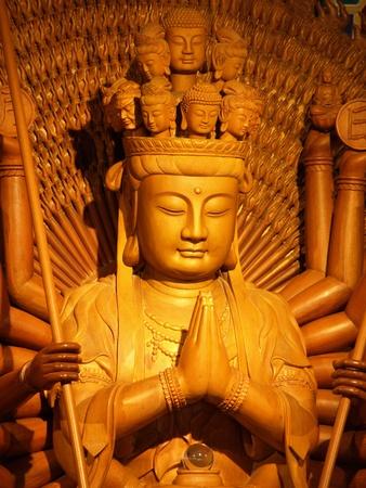 chinese buddha: golden wood chinese buddha statue,Thailand Stock Photo
