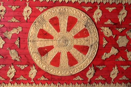 dhamma: woodden Dhammajak, wheel of Dhamma, Dhamma is Buddha
