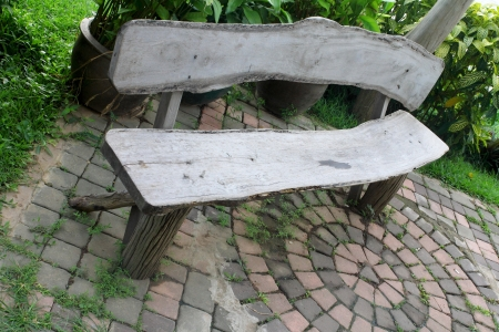 timber bench seat: old wooden chsir in the garden